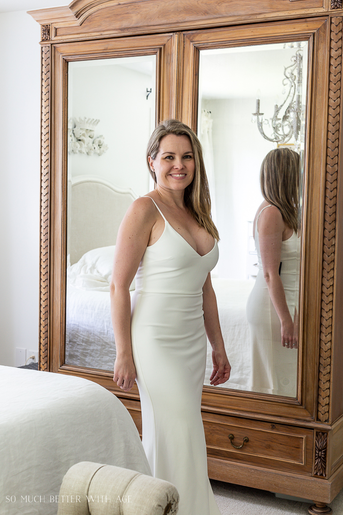 White long dress, armoire in background.
