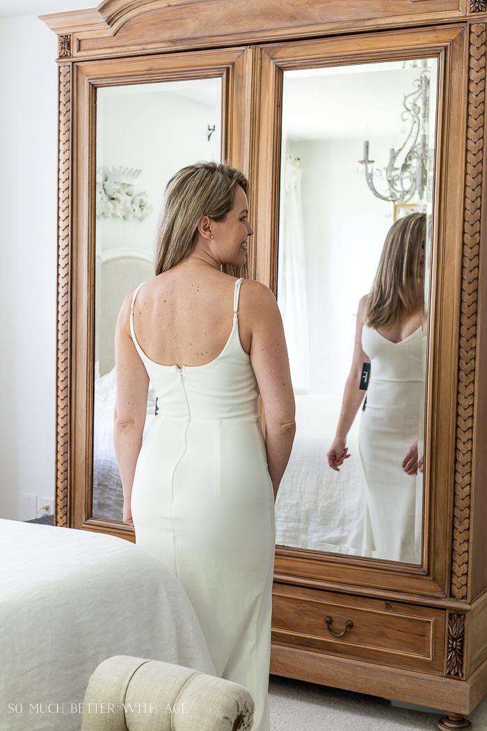 Back of long white dress.