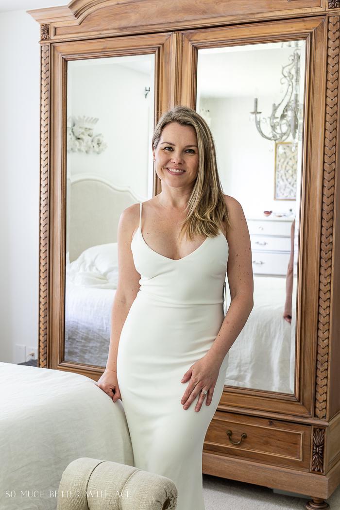 Low cut long white dress.