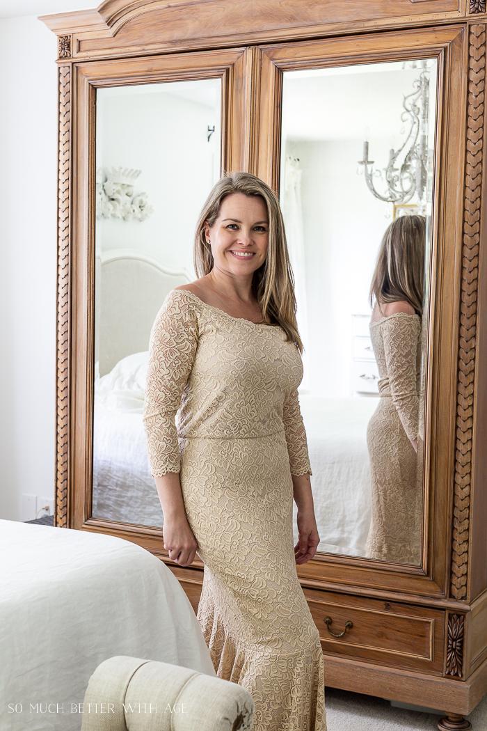 Woman wearing beige coloured lace dress.