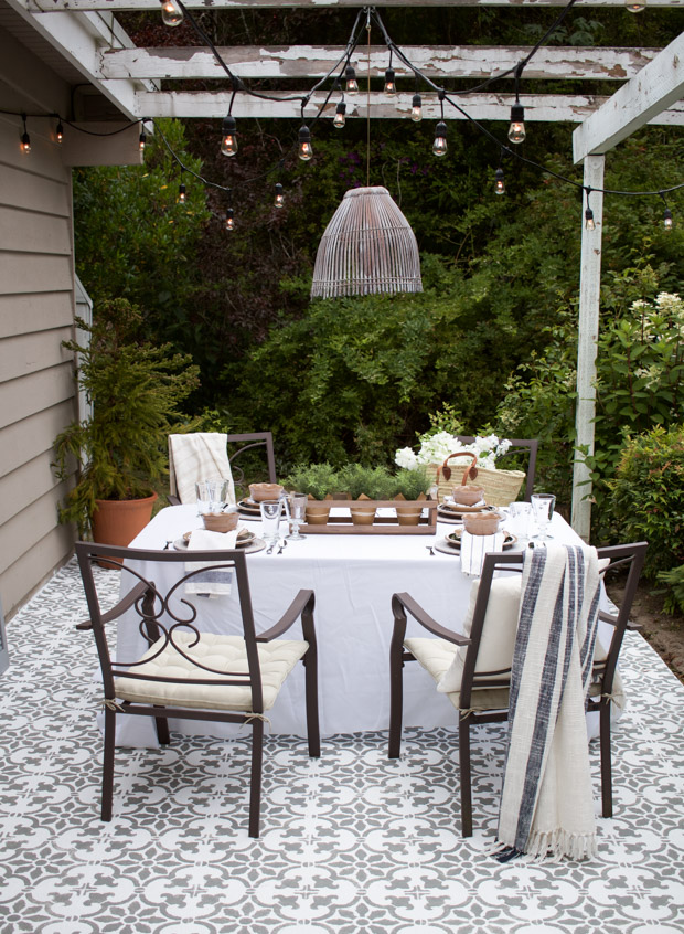 Stencilled floor, outdoor table and chairs, outdoor light.