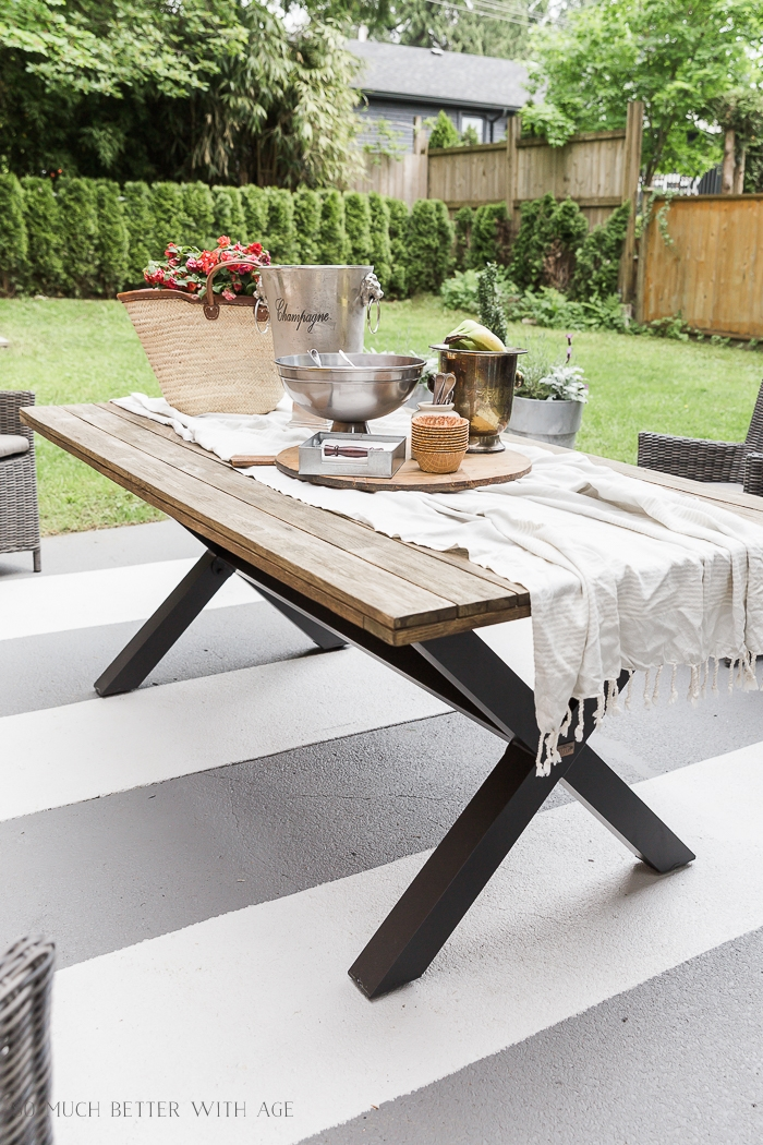 Outdoor table with party supplies on it.