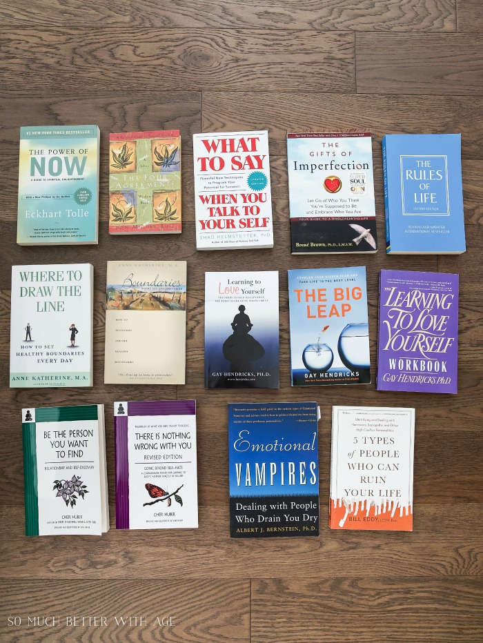 Photos of self-help books on a floor.