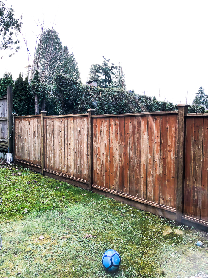 Outdoor fence with stain coming off.