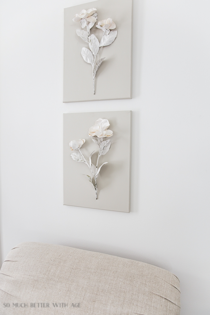 Flowers on canvas on wall.