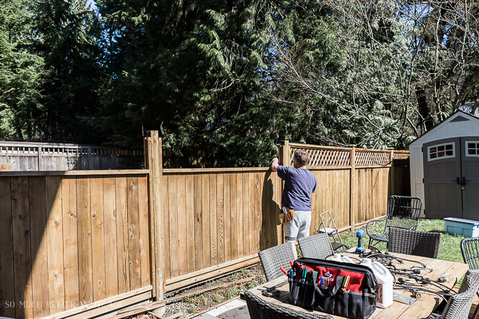 Fixing an outdoor fence.