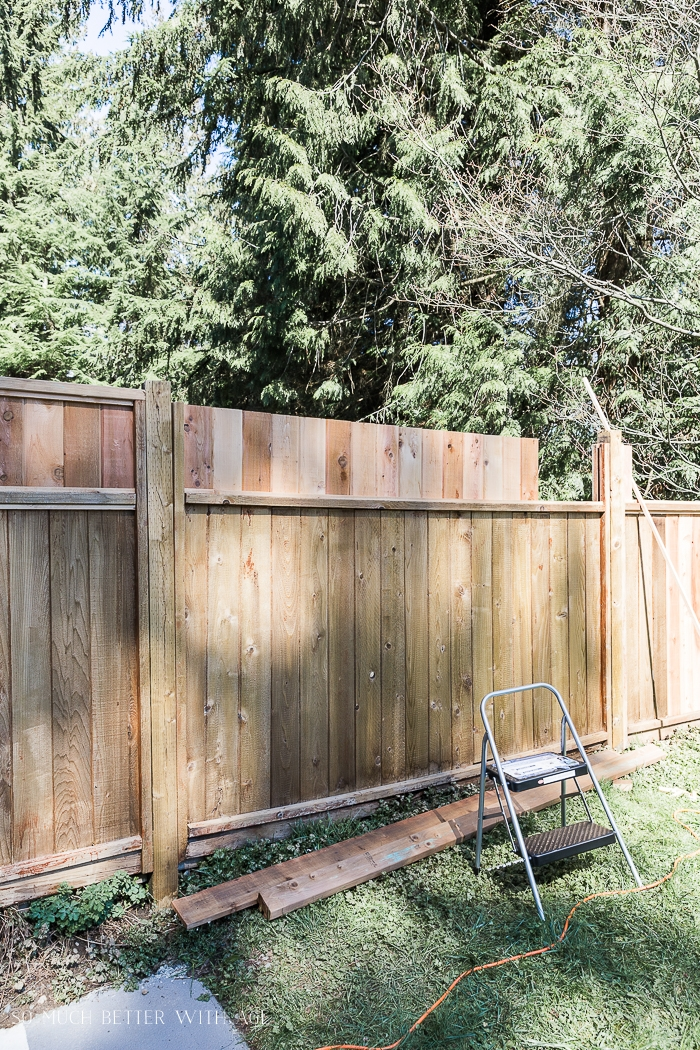 Cedar fence being repaired.