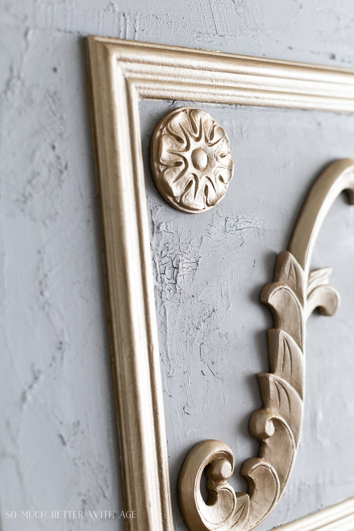 Grey plaster with gold appliques.