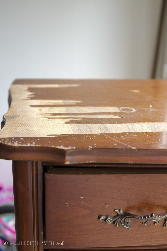Wood veneer coming off top of dresser.