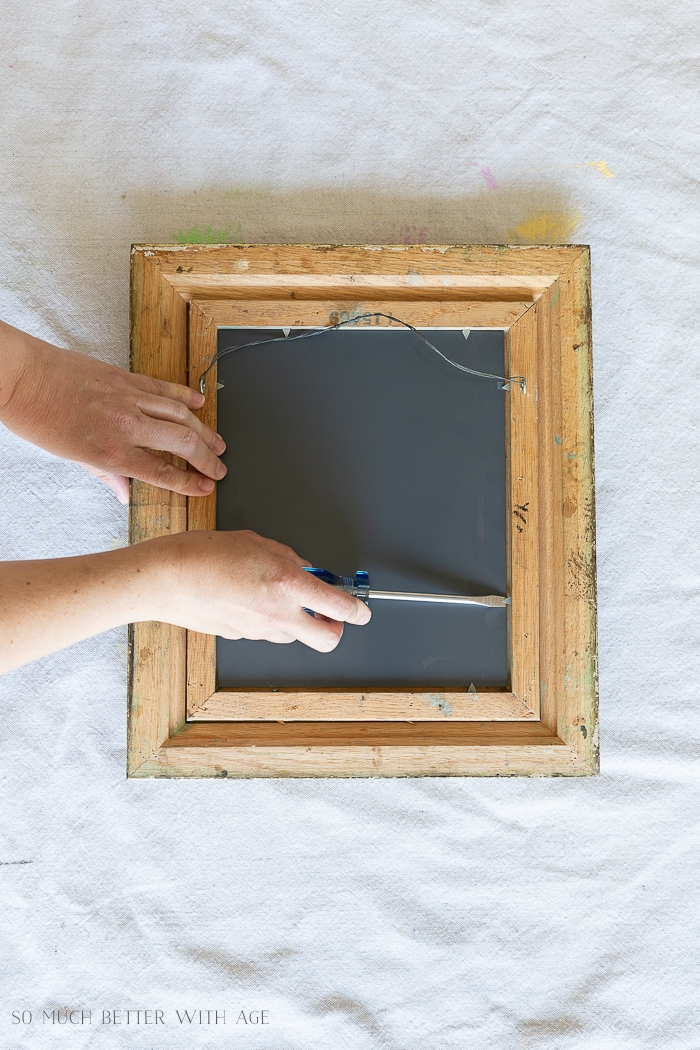 Taking mirror off frame.