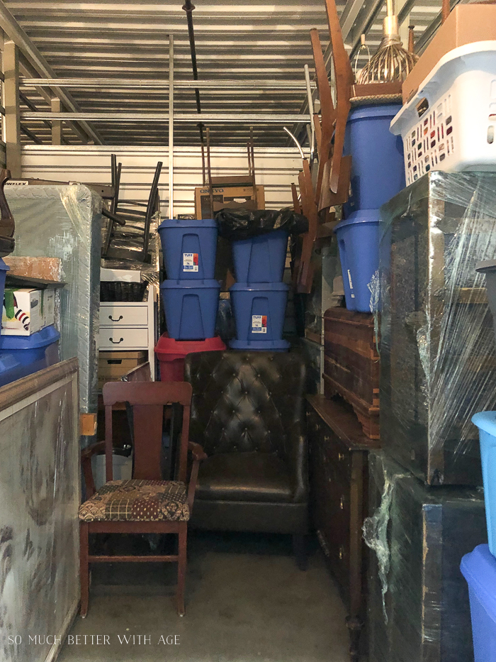 Furniture and bins filled in storage unit.