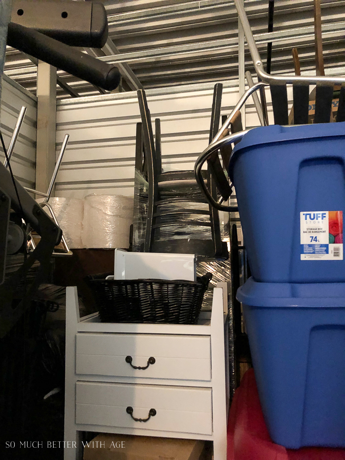 Storage bins and household stuff in storage unit.