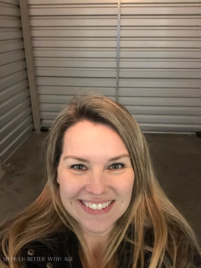 Woman smiling in empty storage unit.