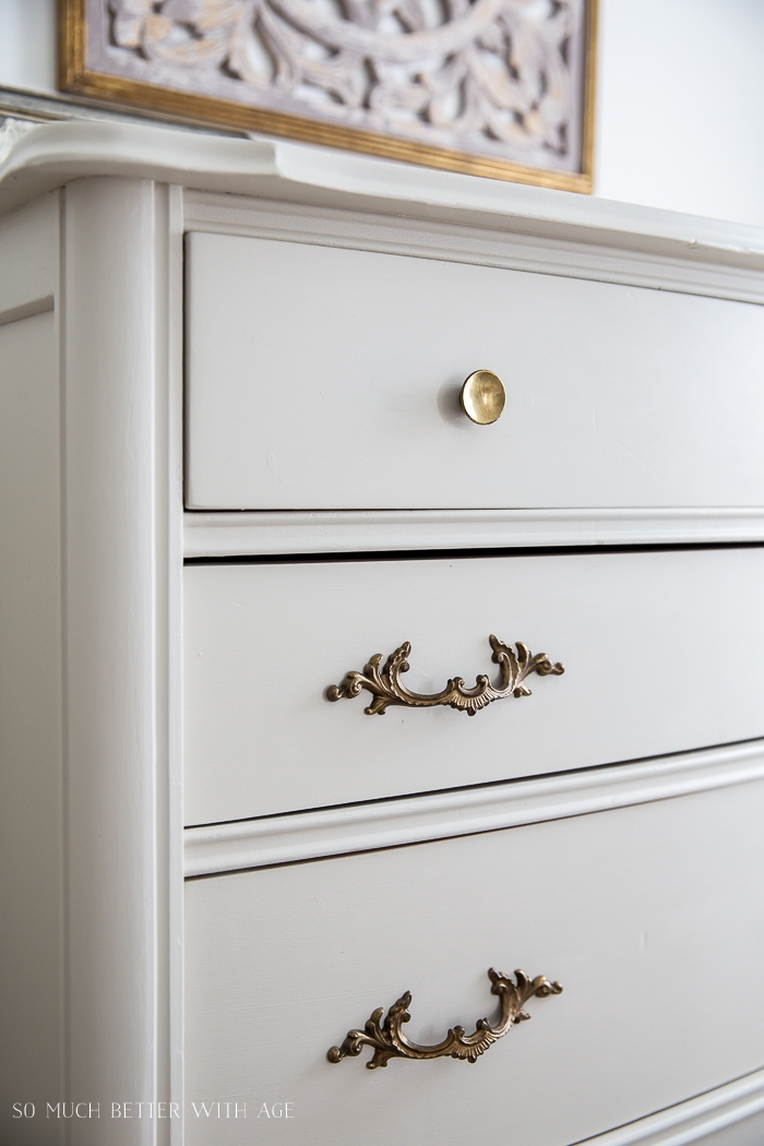 Close-up of vintage dresser handles.