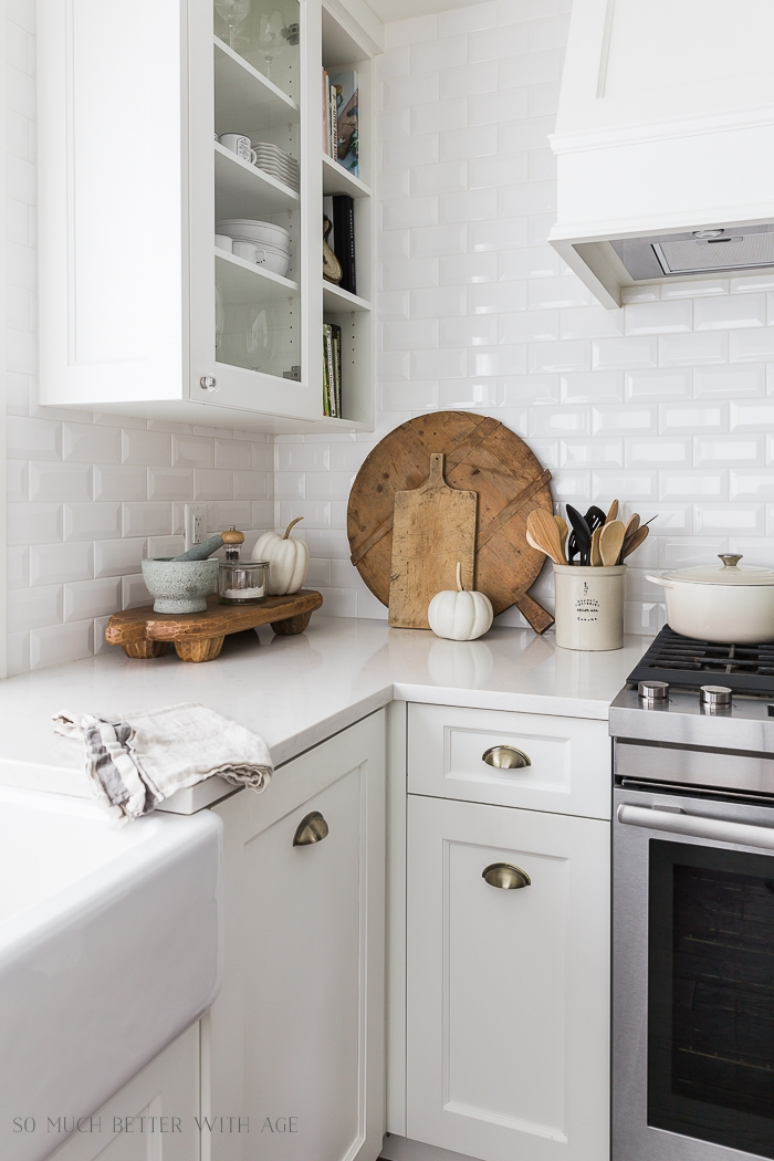White kitchen with wooden boards on counter.