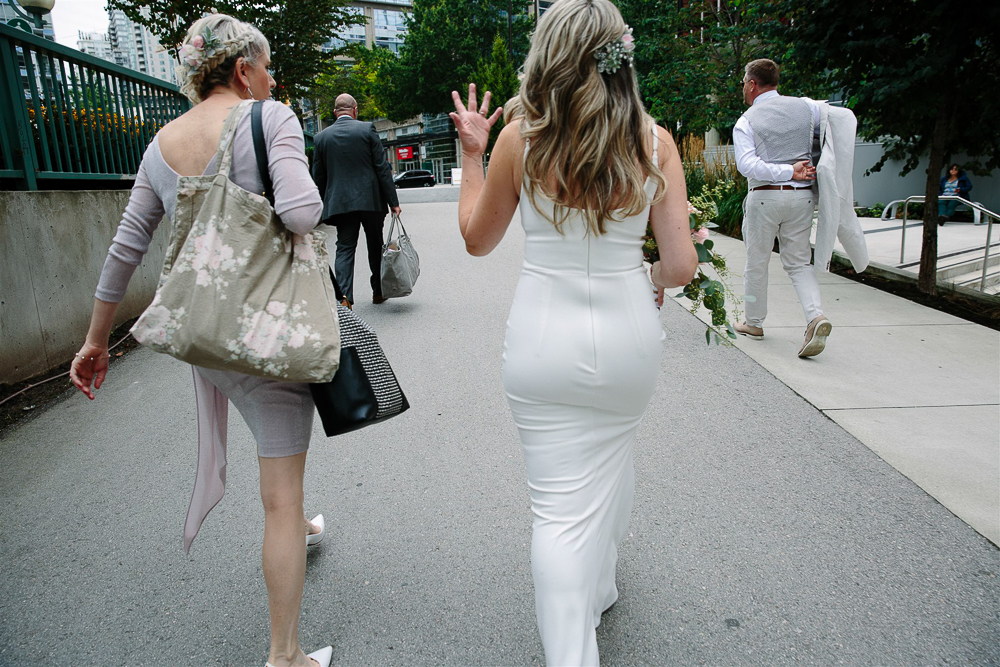 Walking up to the restaurant in her wedding dress.