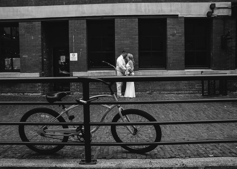 A black and white photo of the two kissing.