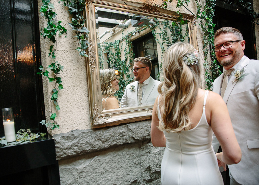 The just married couple looking in a mirror.