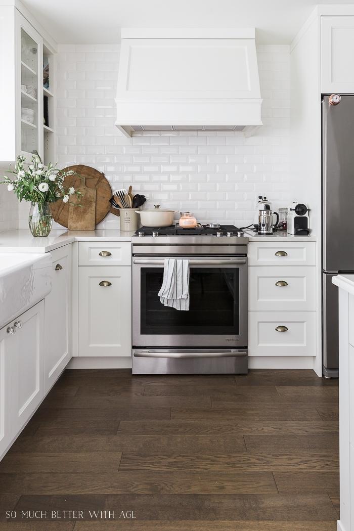 White kitchen with white subway tile.