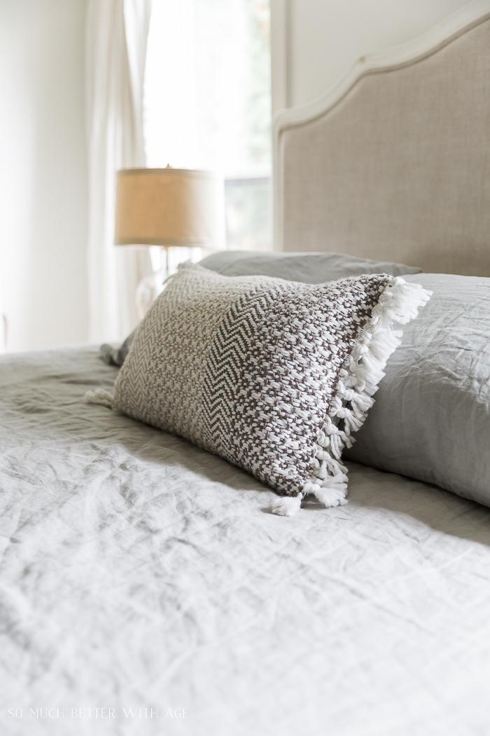 Lumbar throw pillow on bed.
