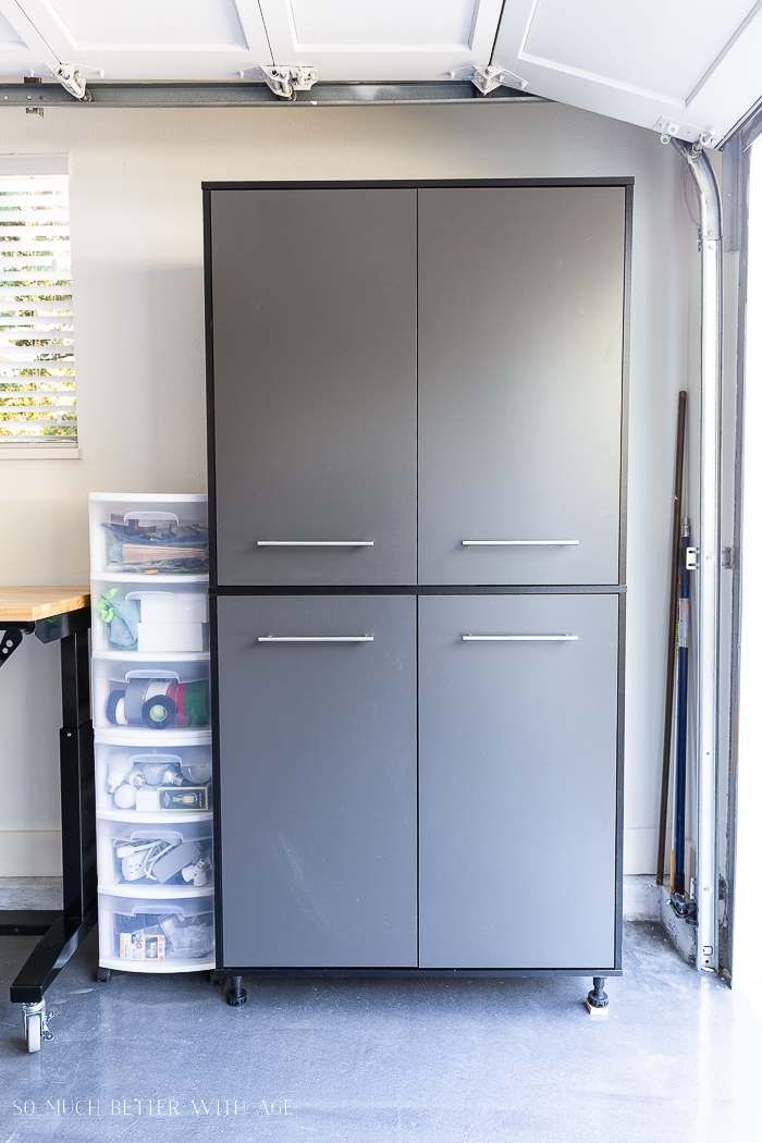 Grey storage cabinet in garage.