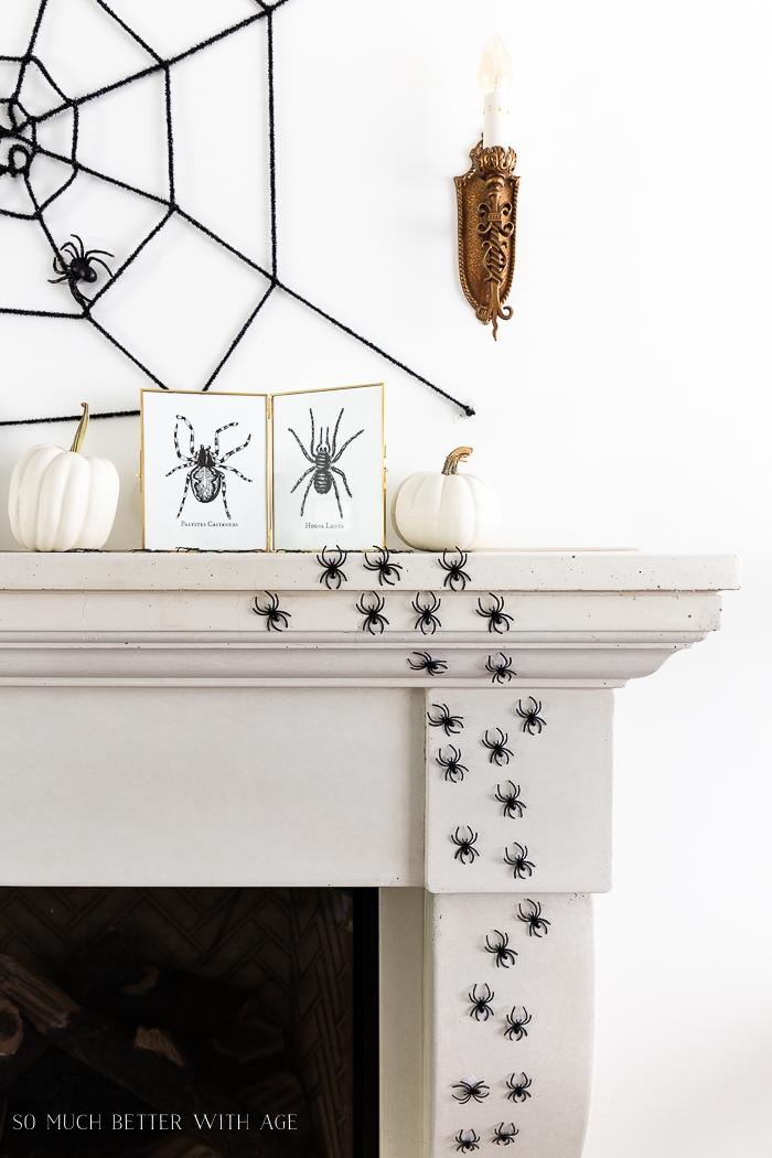 Creepy plastic spiders on mantel for decoration.