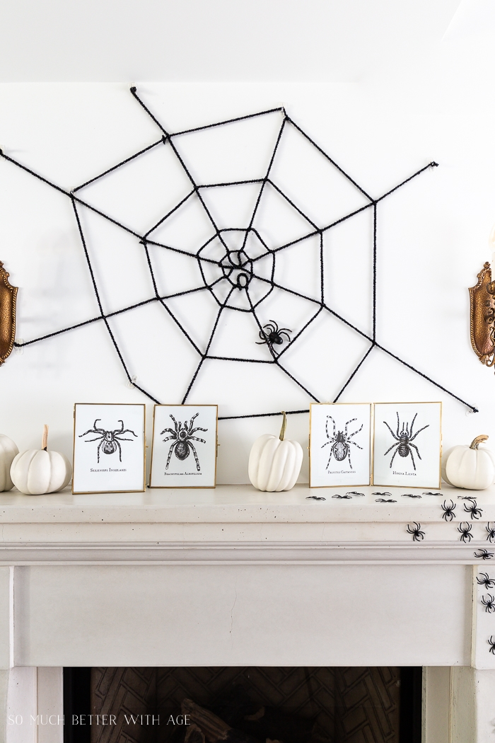 Big spider web above fireplace for Halloween.
