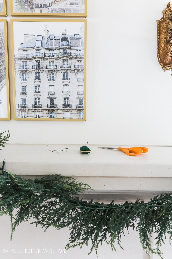 Hanging garland on a mantel.