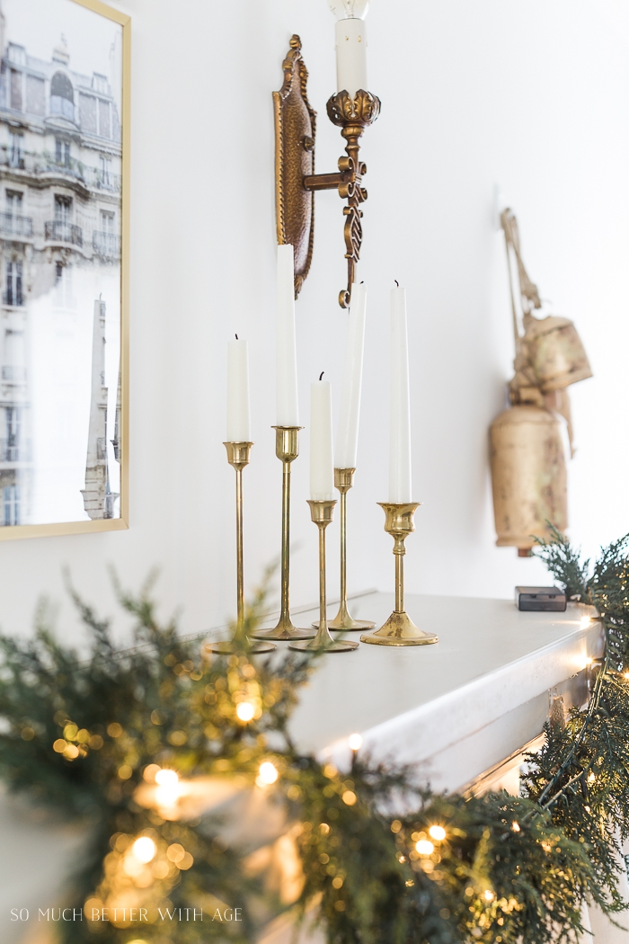 Brass candle holders and wall sconce with bells.