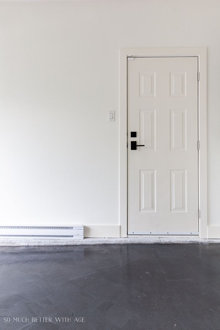 Side door in garage with grey floor.