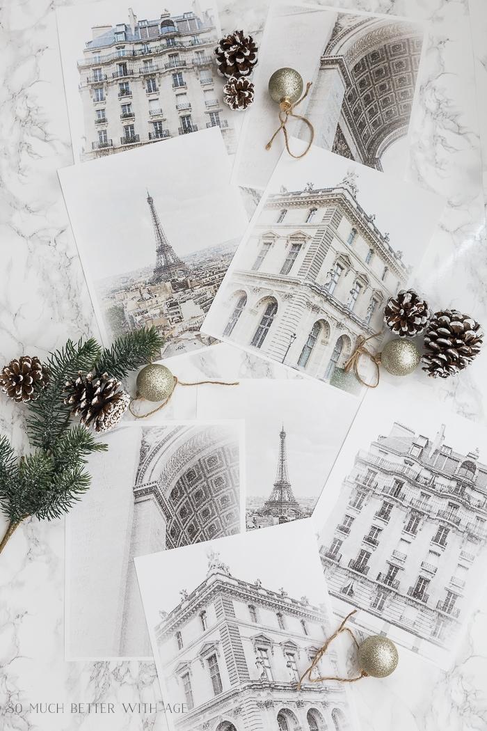 Photos of Paris buildings with Christmas decor.