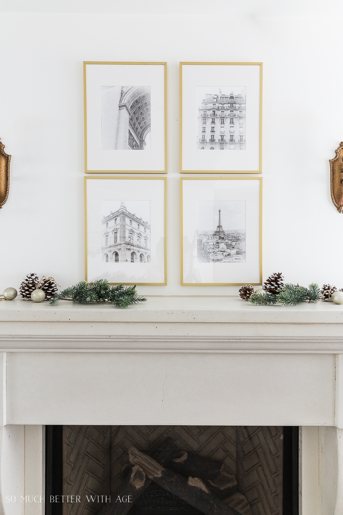 Black and white photos in gold frames.