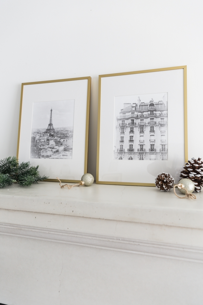 Eiffel Tower and French building in gold frames on mantel.