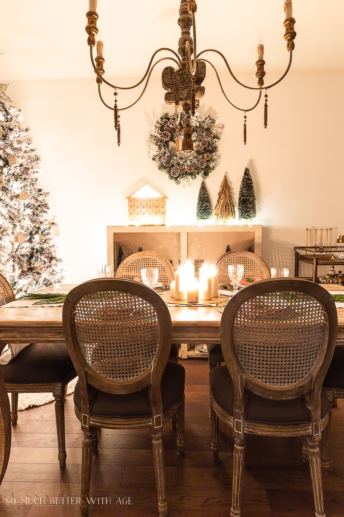 Dining room at Christmas with lights at night.