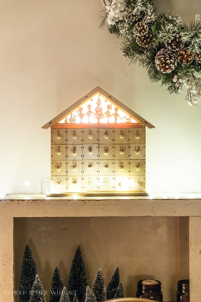 Wooden advent calendar with lights at night.