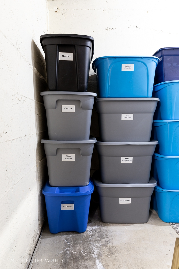 Grey and blue bins stacked nicely on top of each other.