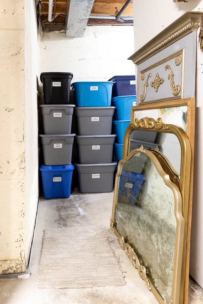 Gold French mirrors and storage bins.