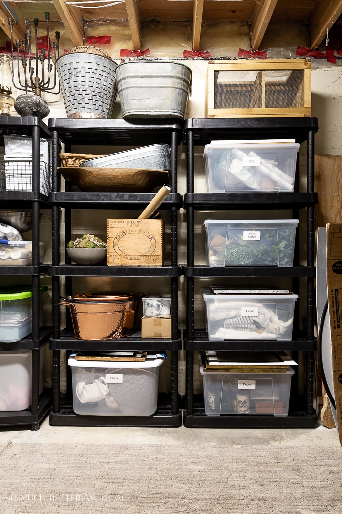 Bins and vintage items on shelf in basement.