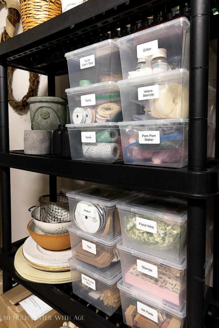 Small plastic bins with craft supplies.
