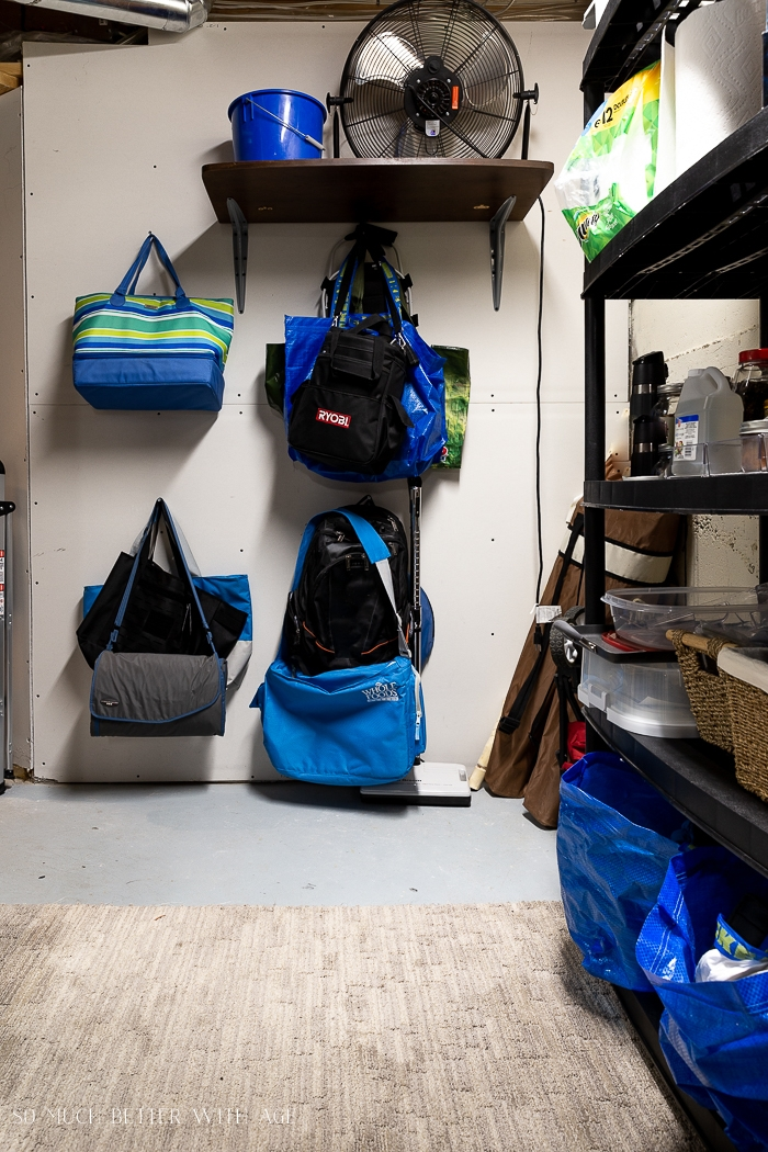 Bags hung on wall in basement.