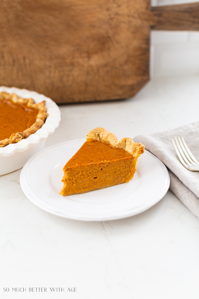 Slice of pumpkin pie on a plate.