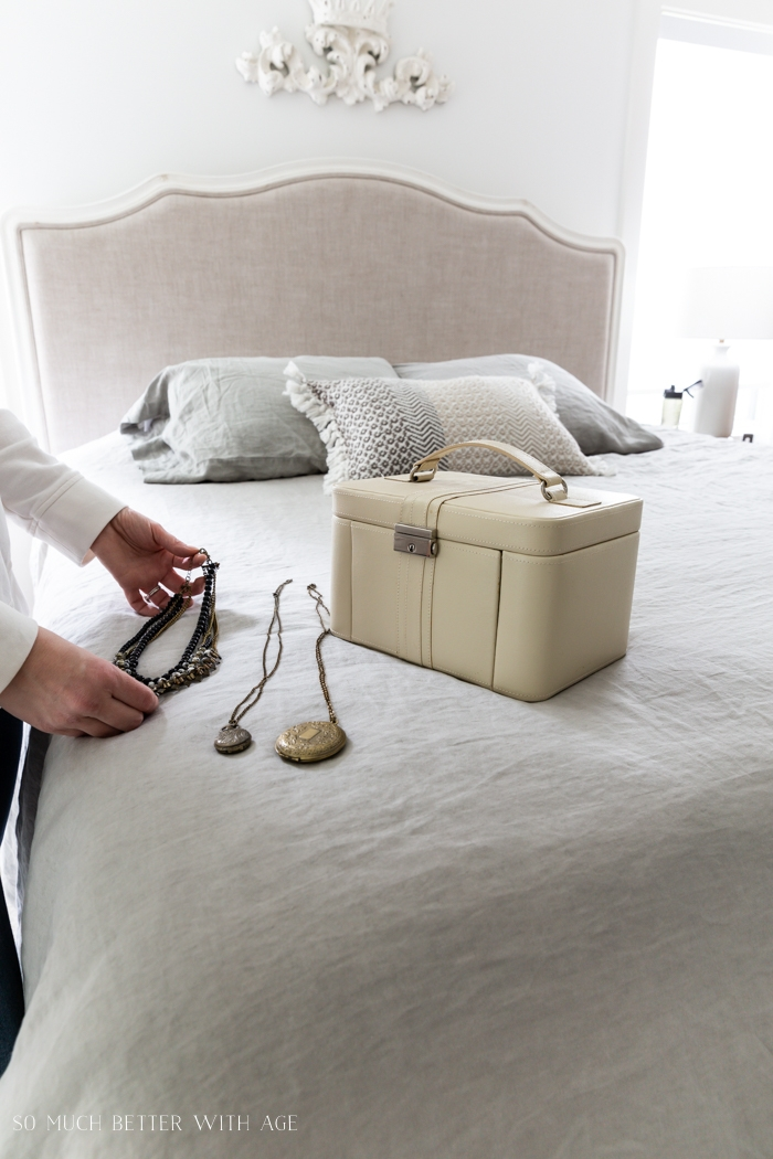 Jewelry and jewelry box on bed.