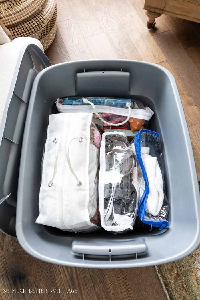 Packed up clothes in storage bin.