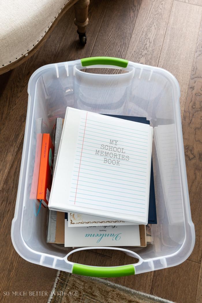 School memory items in a storage bin.