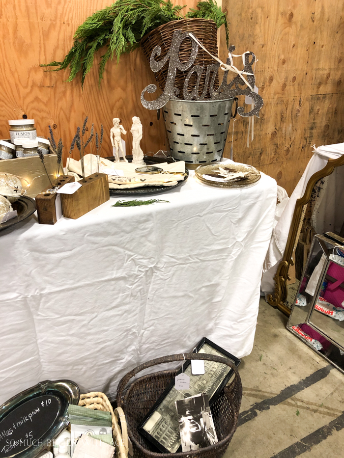 Vintage and antique items for sale at a market.