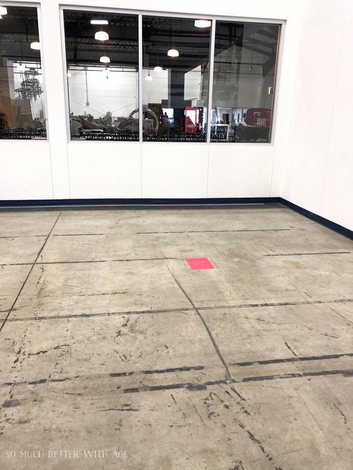 Empty space in room with concrete floor.