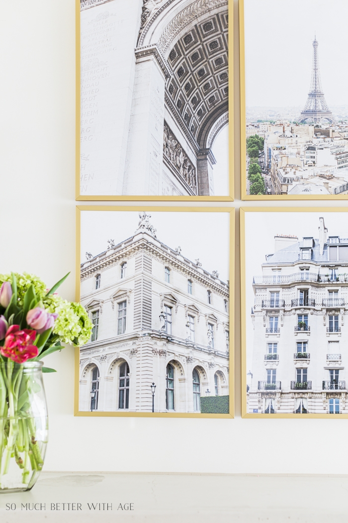 Paris buildings in gold frames on wall.