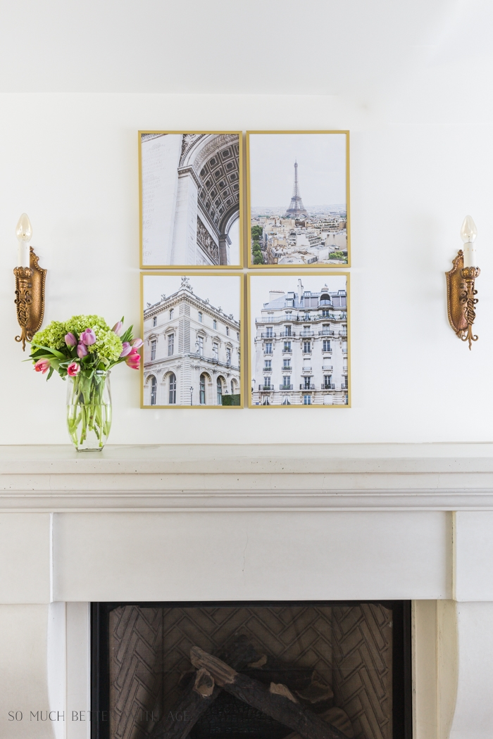 Paris buildings artwork in gold frames.