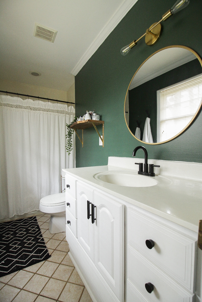 Green painted wall in bathroom by Cassie Bustamante. Rockgarden by Sherwin Williams.