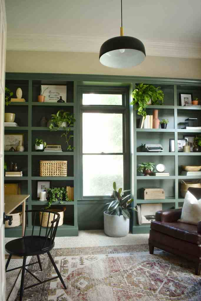 Green painted bookshelves by House on Longwood Lane. Pinecone Hill by Behr.